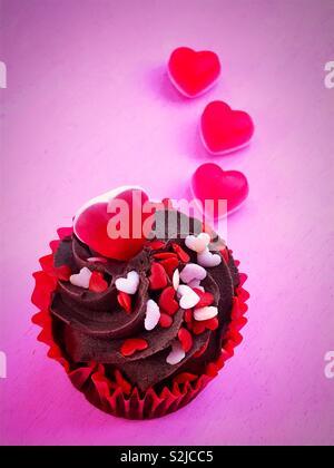 Chocolate Cupcake & Hearts - Stock Image