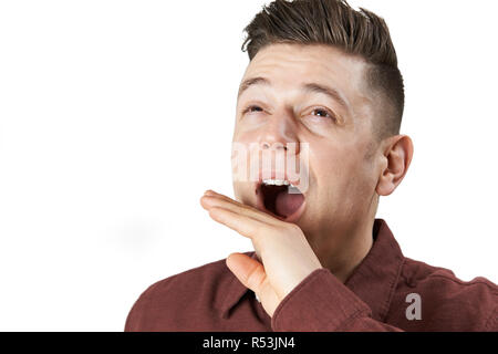 Studio Shot Of Tired Man Yawning - Stock Image