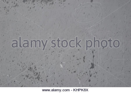 Grey silver textured concrete background wet rain writing - Stock Image