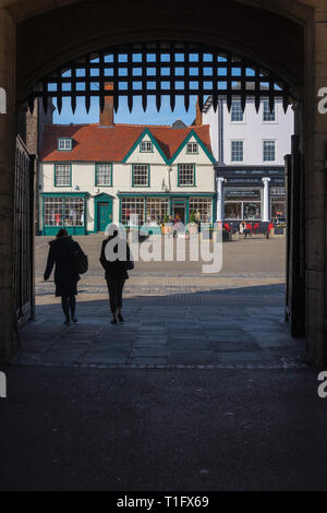 Bury St Edmunds Abbey Gate, view from the medieval Abbey Gate towards shops sited on Angel Hill in the centre of Bury St Edmunds, Suffolk, UK. - Stock Image
