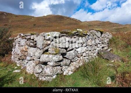 Ruins walls of old stone croft building, Boreraig, Isle of Skye, Scotland, UK - Stock Image