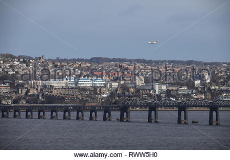 Loganair plane passing over Tay Rail Bridge Scotland  February 2019 - Stock Image