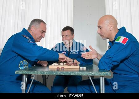 International Space Station Expedition 59 backup crew members Alexander Skvortsov of Roscosmos (left), Drew Morgan of NASA (center) and Luca Parmitano of the European Space Agency (right) take a moment from pre-launch training for a game of chess at the Baikonur Cosmodrome March 7, 2019 in Baikonur, Kazakhstan. Expedition 59 crew: Christina Koch of NASA, Alexey Ovchinin of Roscosmos, and Nick Hague of NASA will launch March 14th onboard the Soyuz MS-12 spacecraft for a six-and-a-half month mission on the International Space Station. - Stock Image