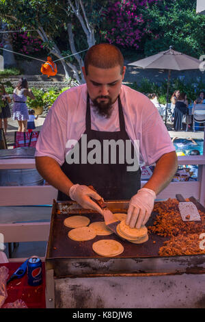 Hispanic man, cook, cooking on flat top grill, grilling meat, grilling meats, griddle, pool party, Castro Valley, - Stock Image