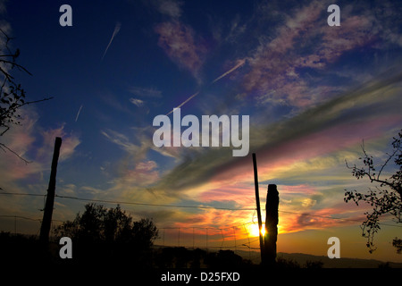 A beautiful sunset on a farm. - Stock Image