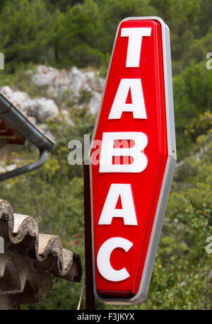 A 'TABAC' sign in Vaucluse, Southern France.  A Tabac is a shop licensed to sell tobacco products in France. - Stock Image