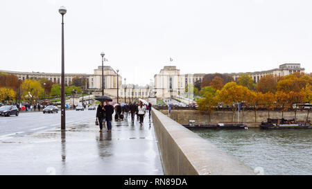 PARIS, FRANCE - NOVEMBER 11, 2018 - Iéna bridge on the River Seine links Eiffel Tower to the district of Trocadéro on the Right Bank - Stock Image