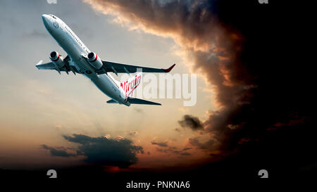Sydney, New South Wales, Australia - October 18. 2016: Virgin commercial passenger jet aircraft departing Kingsford Smith Airport, Mascott. - Stock Image