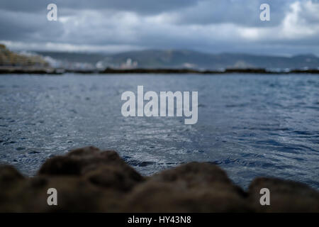 Close-Up Of Beach Against Sky - Stock Image