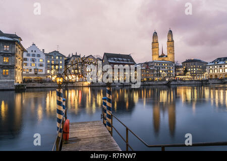 Pier at river Limmat, Grossmunster, old city center of Zurich, switzerland - Stock Image