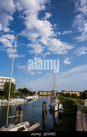 Yachts and sailboats moored at the dock in Caorle - Italy in a beautiful sunny day - Stock Image