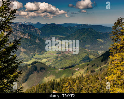 View from a trail to  Mount Wendelstein in Upper Bavaria in the late Spring, featuring the Alps, a valley and a town,  at a distance - Stock Image