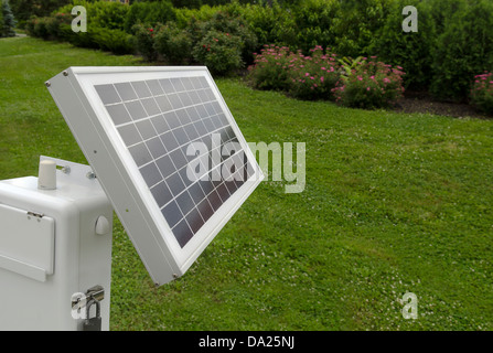 solar panel on residential lawn - Stock Image
