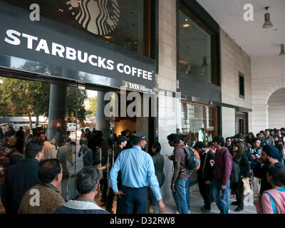 People queuing outside Starbucks flagship store in Connaught Place on its opening day, the first one in Delhi India. - Stock Image