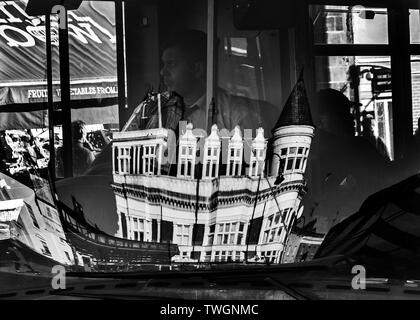 black and white reflection in london bus windscreen of kentish town Assembly house pub London - Stock Image