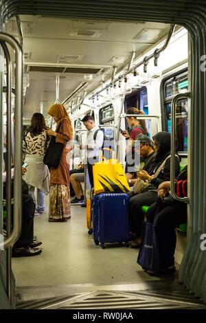 Passengers on the MRT (Mass Rapid Transit), Kuala Lumpur, Malaysia. - Stock Image