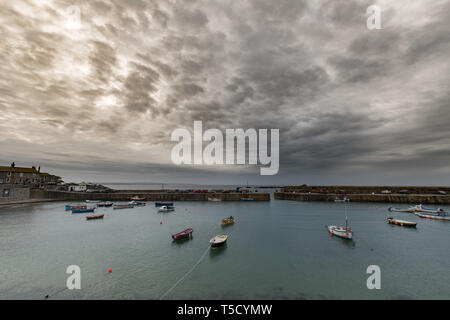 Mousehole, Cornwall, UK. 24th Apr, 2019. UK Weather. Still mild, but overcast and windy start to the day for south west Cornwall. Credit: Simon Maycock/Alamy Live News - Stock Image