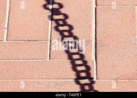 shadow on the floor of a metal chain - Stock Image