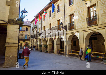 Laguardia, Álava province, Basque Country, Spain : People at the Plaza Mayor square with both the new and the old townhall of the historic town of Lag - Stock Image