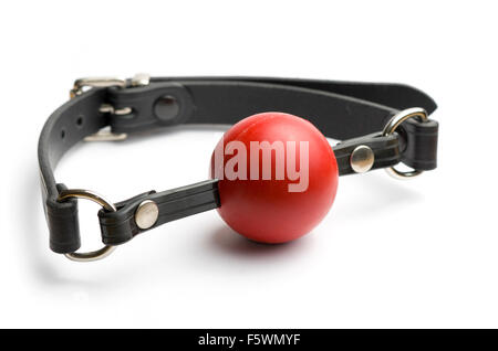 Red ball gag on white background. - Stock Image