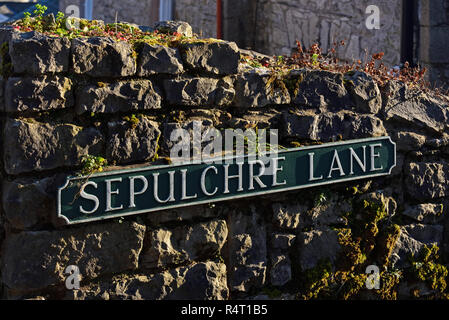 Cast iron street nameplate. Sepulchre Lane, Fellside, Kendal, Cumbria, England, United Kingdom, Europe. - Stock Image