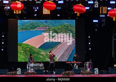 London, UK, 10 February, 2019. Chinese New year celebration at Trafalgar square , London, UK. Group perfromance by Chinese young men on stage. Credit: Harishkumar Shah/Alamy Live News - Stock Image