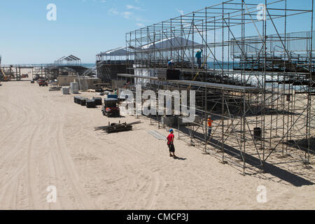 July 19th 2012  Construction crews work on erecting the stands, stadiums ,seating and bleachers south of Huntington - Stock Image