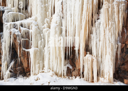 Ice covered rocky outcrop on the North Shore of Lake Superior, Minnesota. - Stock Image