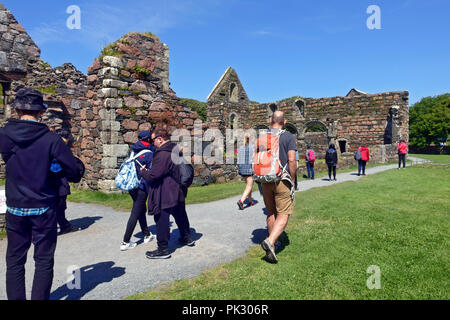 Tourists visiting the Nunnery on Iona - Stock Image
