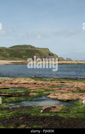 Looking across the bay at Aberdour Beach, Aberdeenshire, Scotland, UK. - Stock Image