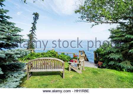 Bench and chairs by fire pit overlook Lake Superior, northern Minnesota, USA. - Stock Image