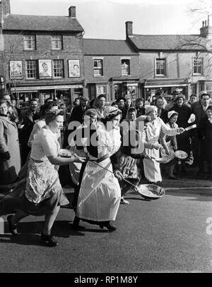 A view of a village pancake race in action.  February 1951  P005030 - Stock Image