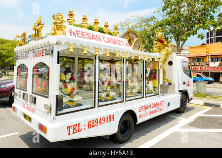 Hindu hearse decorated with garlanded Hindu deities. Little India, Singapore. Modern hearse; white hearse; - Stock Image