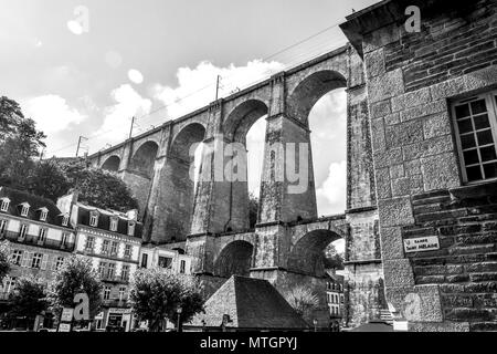 Layers of stone construction in houses, churches, and a viaduct in Morlaix, Brittany, France. - Stock Image