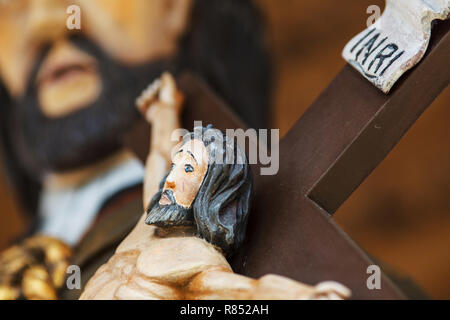 Jesus Christ on the cross old wooden sculpture - Stock Image