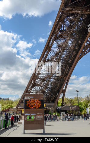 Delays at Eiffel Tower. Technical fault matrix message. Operating with a single lift. Waiting time 2 hours. Steel latticework leg of Tour Eiffel - Stock Image