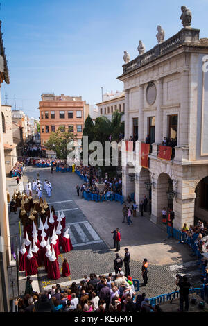 Resurrection Parade on Easter Sunday in Gandia Spain with the brotherhoods in their colourful outfits with pointed - Stock Image