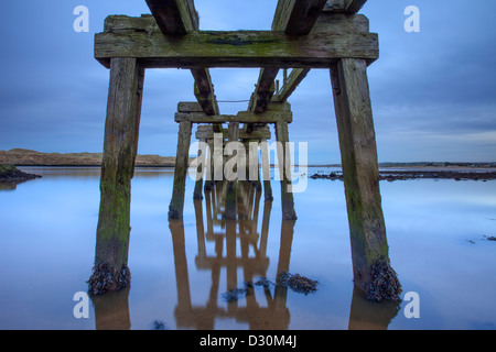 Disused Pier at dusk, CastleRock, Londonderry. - Stock Image