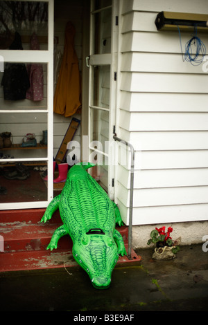 Inflatable crocodile series Going out of the house - Stock Image