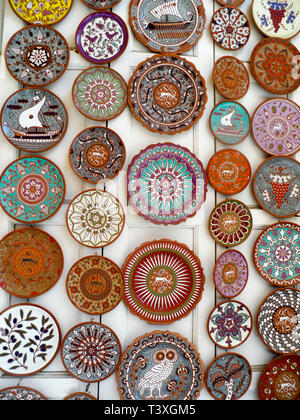 A selection of handmade and decorated  plates on a market stall in Rhodes old town, Rhodes, Greece. - Stock Image
