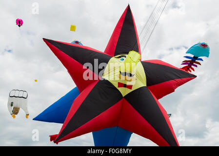 Portsmouth, UK. 15th August 2015. A large star shaped kite flies at the International Kite Festival. Credit:  MeonStock/Alamy - Stock Image
