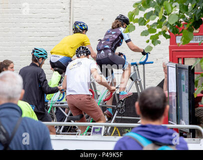Bicycle built for four having trouble turning at the OVO Women's Tour. - Stock Image