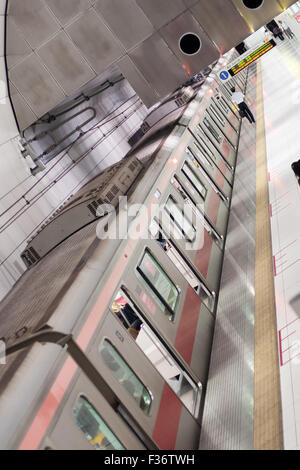 Train subway seen from above with conductor walking to front - Stock Image