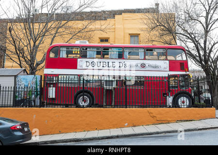 ASHEVILLE, NC, USA-2/16/19: Double D's coffee & Desserts is in a double decker bus, located on Biltmore Avenue in center city. - Stock Image