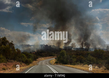 Forest fires burning in distance, East McDonnell Ranges, Alice Springs, Australia - Stock Image