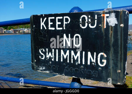 Keep out, no swimming danger sign  at Rothesay harbour, Scotland - Stock Image