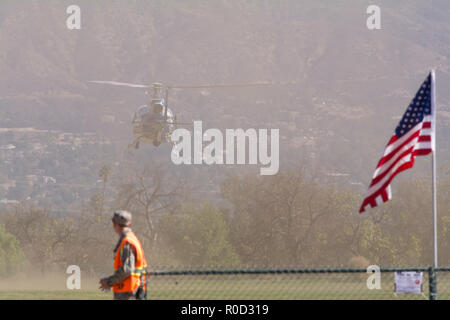 Los Angeles, California USA 3 NOV 2018 California Highway Patrol helicopter taking off in the dust at the American Heroes Airshow in Los Angeles Credit: Chester Brown/Alamy Live News - Stock Image