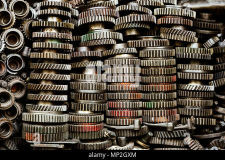 Stacks of colorful engine gears on a street in Bangkok, Thailand - Stock Image