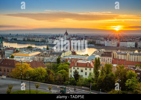 Budapest, Hungary - Aerial panoramic view of Budapest at sunrise with sunlight, residential buildings of Buda side and Parliament of Hungary - Stock Image