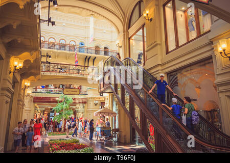 Moscow, Russia - July 31, 2018: The interior of a huge beautiful State Department Store in Moscow with tourists and visitors - Stock Image